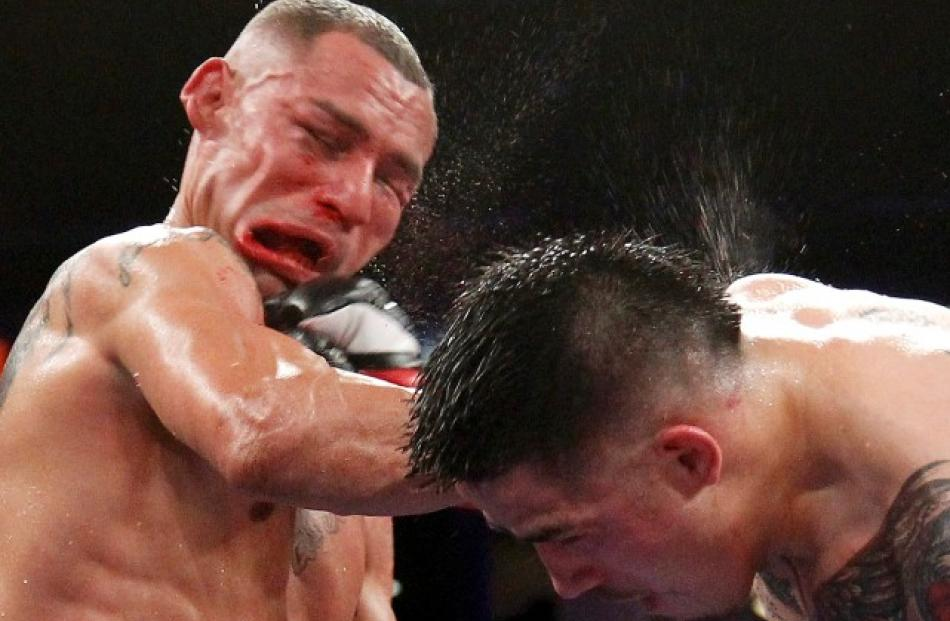 Brandon Rios (R) of the US connects with a punch on compatriot Mike Alvarado during their WBO...