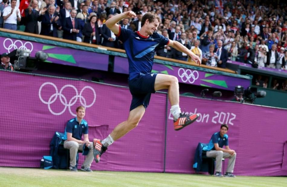 Britain's Andy Murray celebrates after defeating Switzerland's Roger Federer in the men's singles...