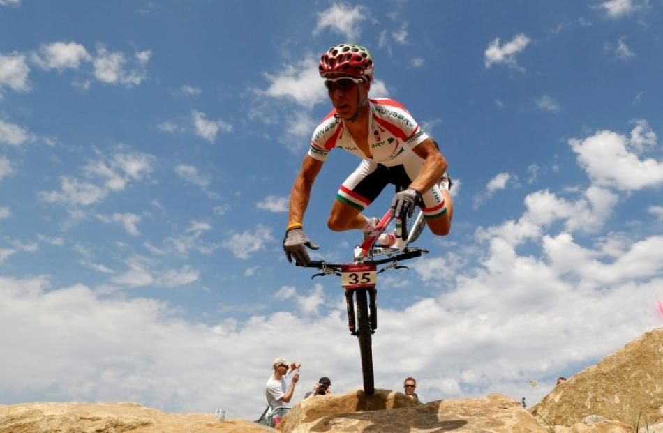 Hungary's Andras Parti falls during the men's cross-country mountain bike event at Hadleigh Farm...