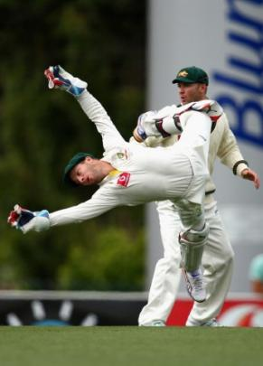 Matthew Wade of Australia dives for the ball on day four of the first test between Australia and...