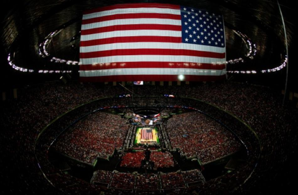 The US national anthem is performed before the Louisville Cardinals take on the Kentucky Wildcats...