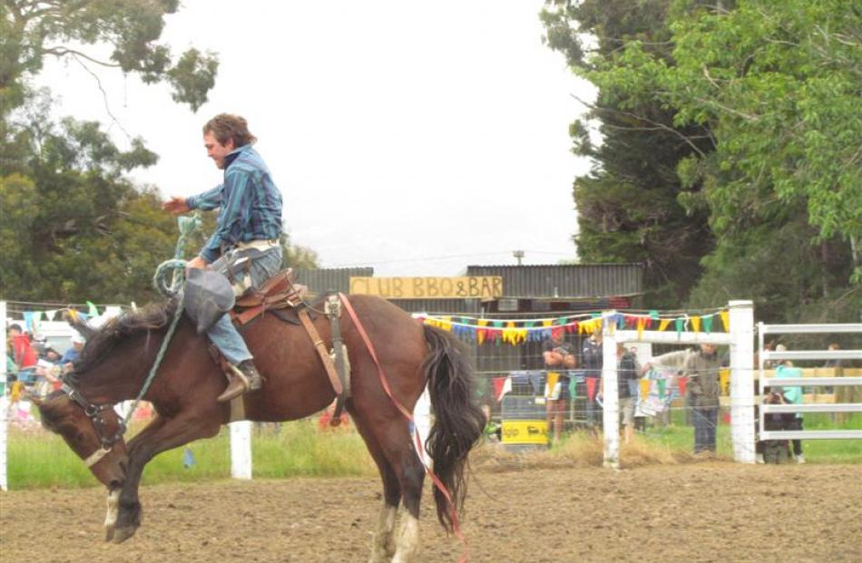 Hayden Tisdall (18), of Oamaru, holds on for a second-place finish in the second division saddle...