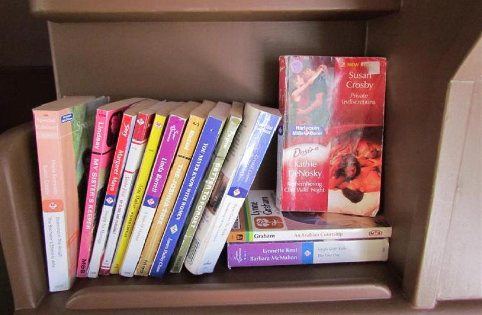 A stack of Mills and Boon books for guests' reading pleasure.