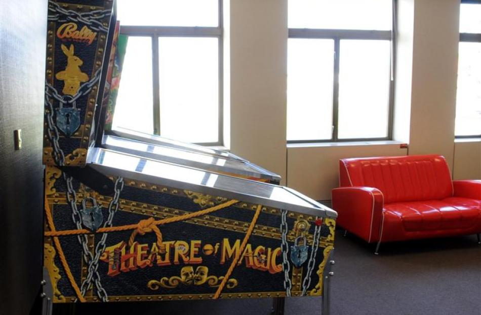 A Theatre of Magic pinball machine completes  the central Dunedin office.