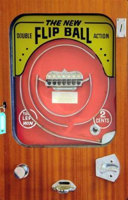 An old flip ball machine hangs on a wall inside Jonathan Usher's central Dunedin office.