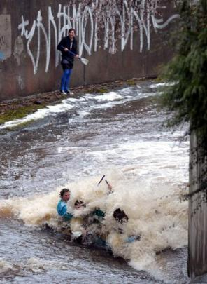 With the Water of Leith in flood following heavy rain it was a fair bet students would be pitting...