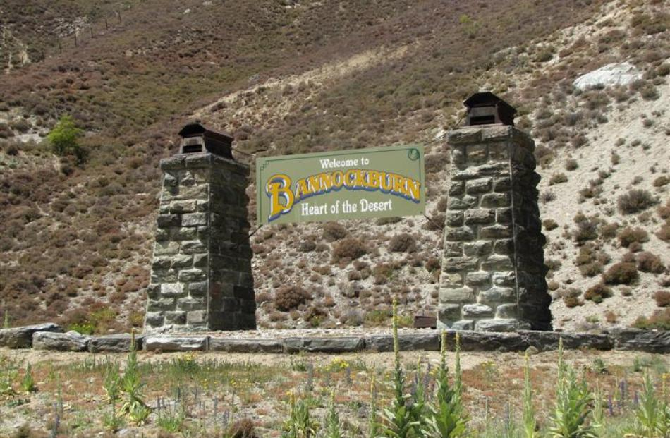 A sign greets visitors to Bannockburn as they leave the bridge over the Kawarau River.