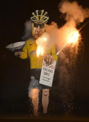 An effigy of U.S. cyclist Armstrong burns during Bonfire Night celebrations in Edenbridge, south...