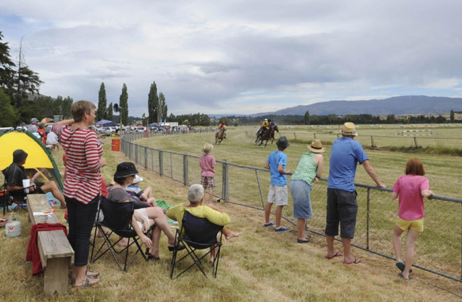 Spectators watch the 1/4 Mile Sprint at the Hawea Picnic Races. Photos by Linda Robertson.