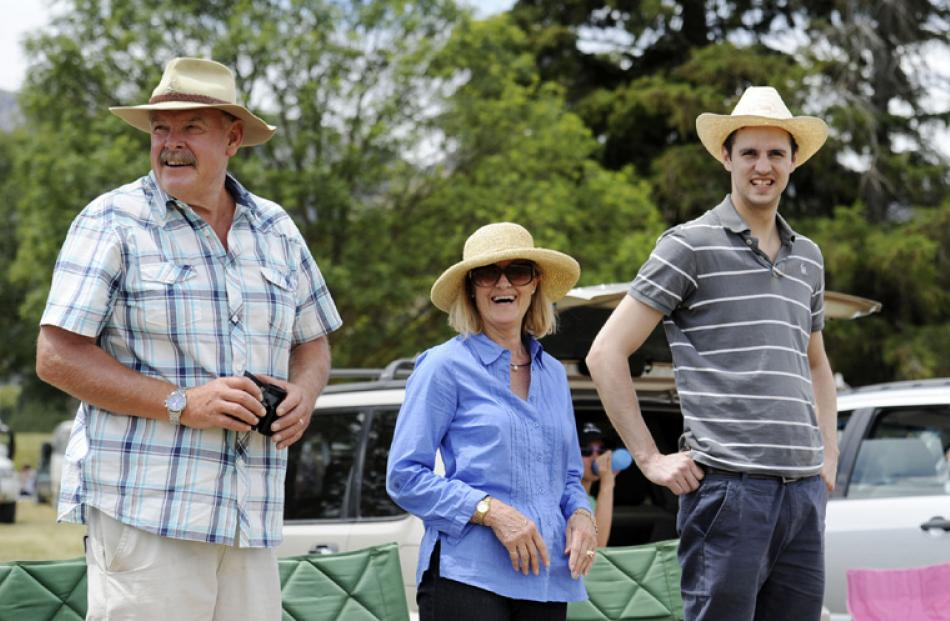 Russell and Lynda Duff of Wanaka watch the first race with their son-in-law Neil Williams of London.