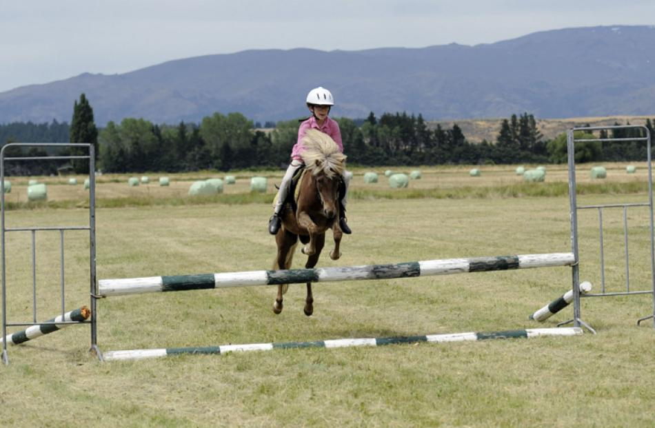Molly Todd (10) of Haast clears the straight bar jump on her pony Louie in the young peoples events.