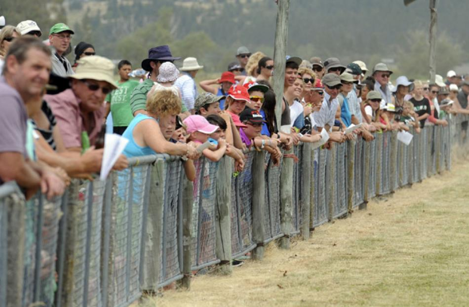 The crowd watches the Alan May Memorial Trot.