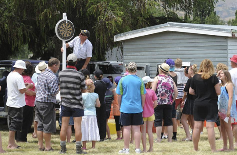 Gerald Birley of Hawea waits for the chocolate wheel to stop spinning in front of a large group.