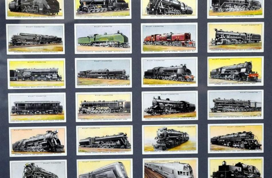 Cards from old cigarette packets, featuring locomotives, are framed to hang on the wall.