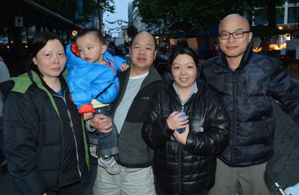 The Cheng family, from left,  Connie, Sam, Dominic, (20 months), Carmen and Patrick prepare to...