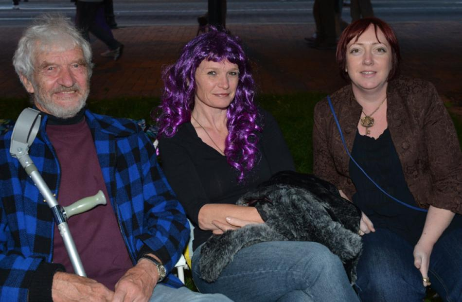 Dave and Fran Radley, and Kirsty Lewis-Bleakley, of Dunedin, sit in the Octagon watcing the...