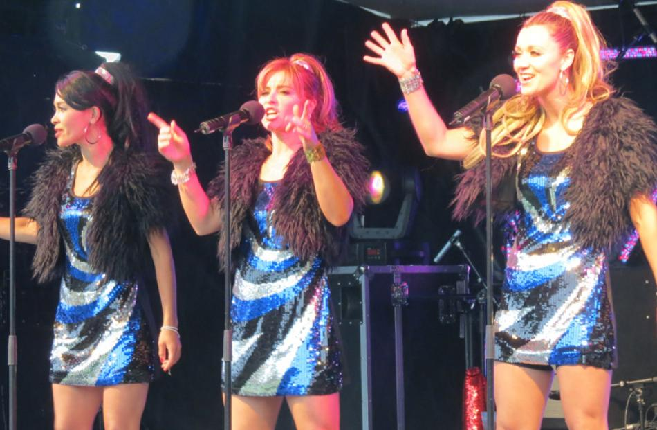 The Sequin Sisters sang their hearts out and had the crowd dancing in the rain on Earnslaw Park,...