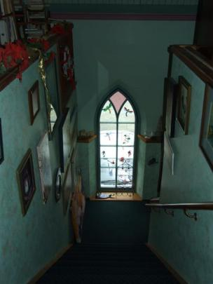 Looking down the stairs from the mezzanine floor at one of the many arched windows restored by Mr...