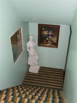 The former church is dotted with sculptures and artworks, even in the stairways.
