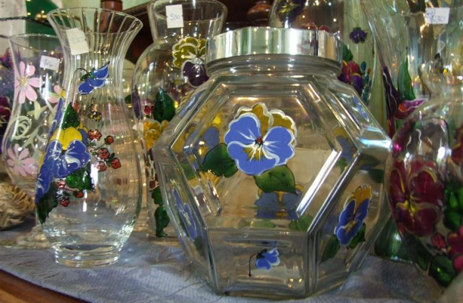 The main area open to the public features Christine's art. Pictured is glassware decorated with...