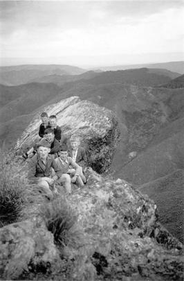 Gathering at Pulpit Rock, in the Silver Peaks, in early February 1945, are Leith Valley, Dunedin,...