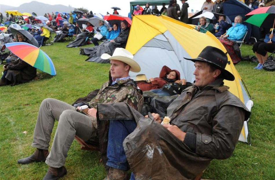 Jared Bekhuis (22), left,  and his father, Richard Bekhuis, both of Invercargill, watch the action.