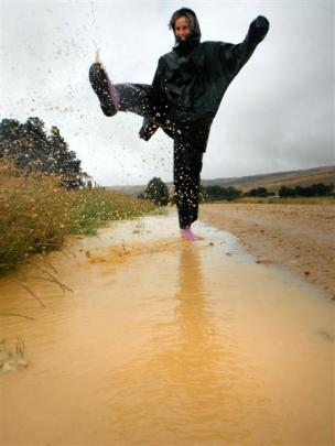Romy Wales (15) kicks up a puddle on the Knobby Range, near Roxburgh, yesterday. Photo by Tarin...