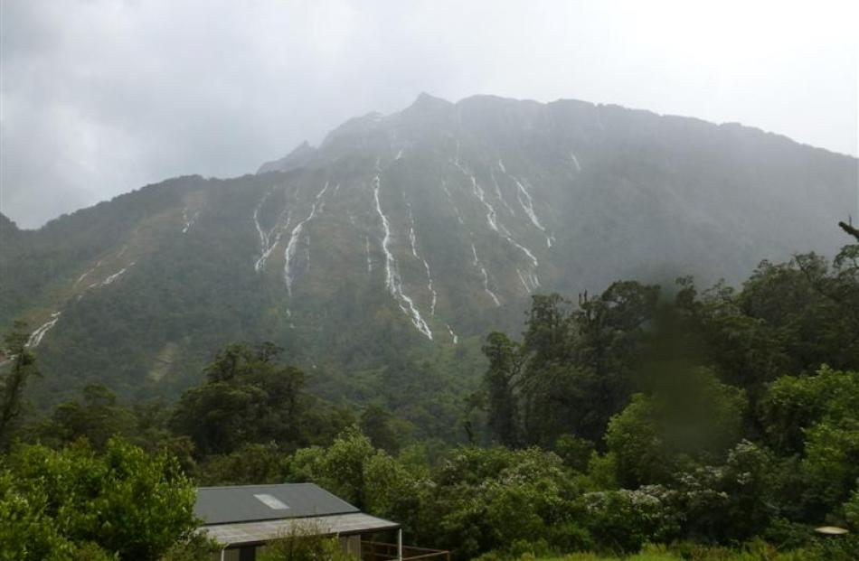 Water cascades down a mountain above Dumpling Hut on the  track earlier this week.  Photo by...