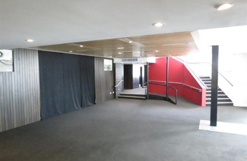 Another view of the redecorated foyer, leading to upgraded toilets and the staircase to the...