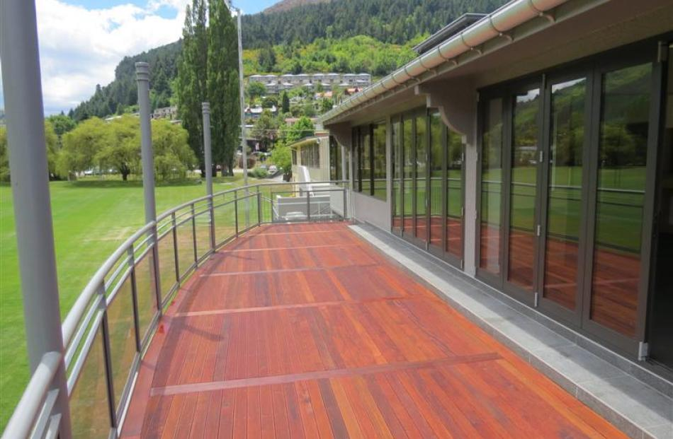 Timber decking and a metal and glass balustrade make for an attractive balcony, which is an ideal...