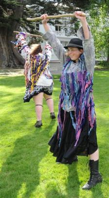 Jack Frost Morris Cub dancers Ana Clarke (left) and Helen Jones-Rippey perform. Photos by Craig...