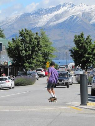 Snow on the mountains as downtown Wanaka is blazing in midsummer sun.