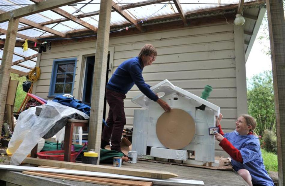 Purakaunui crib owner Anthony Ritchie and daughter Annabelle Ritchie (14) build a hobbit hole to...
