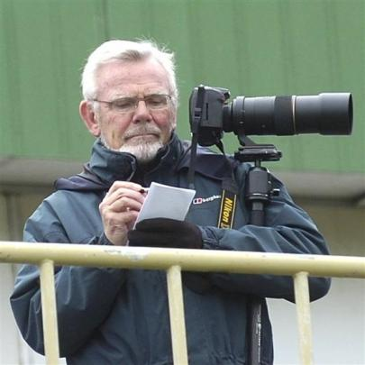 Football writer Rab Smith armed with camera, pen and pad  at an Otago United match. Photos from...