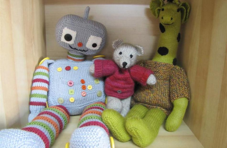 Chip the Robot, in 8-ply merino, Clyde Bear, in possum, and Giraffe in 4-ply merino are examples...