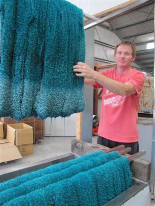 Glenn Kelly dyes  a merino-mohair blend at the factory.