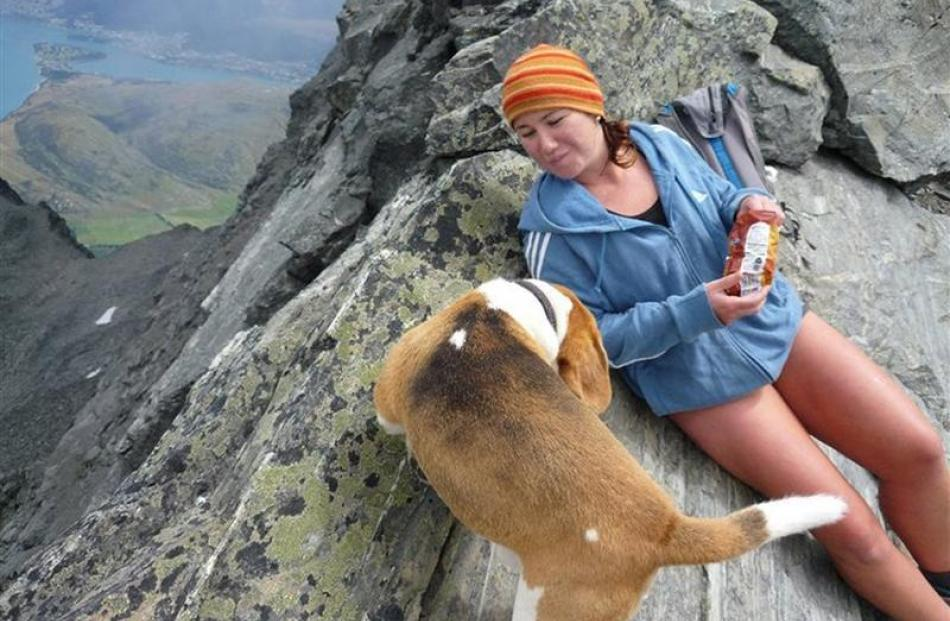 Olivia Caldwell and beagle Paddy take in the view from  Lake Alta at the top of the Remarkables....