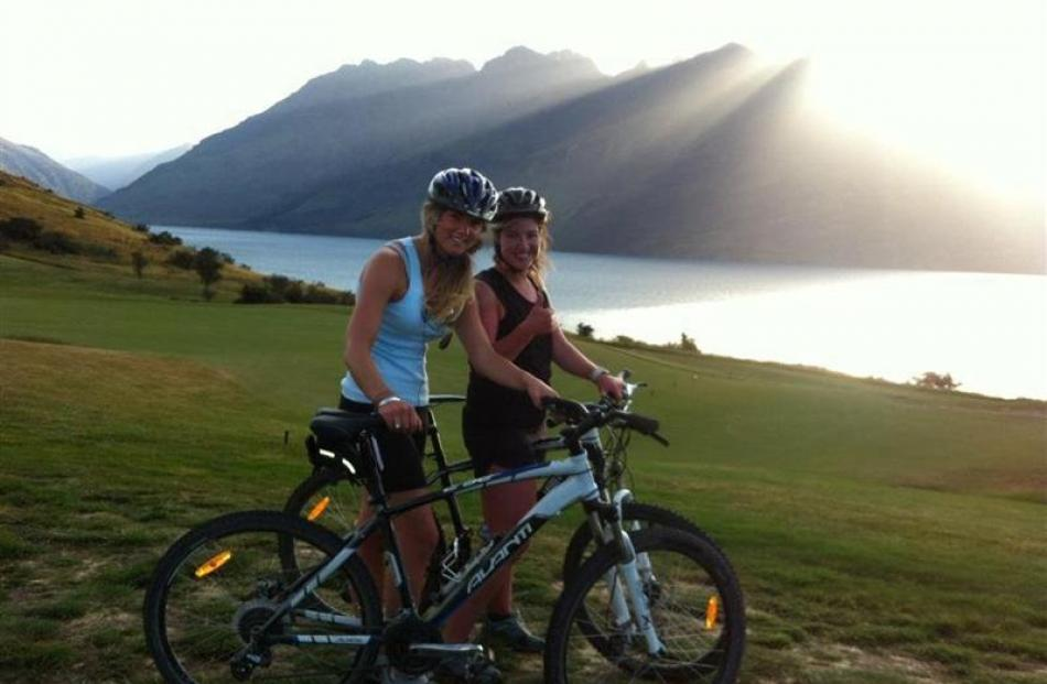 Phillipa Bennett (left) and Olivia Caldwell enjoy an evening ride on the Jack's Point track  at...