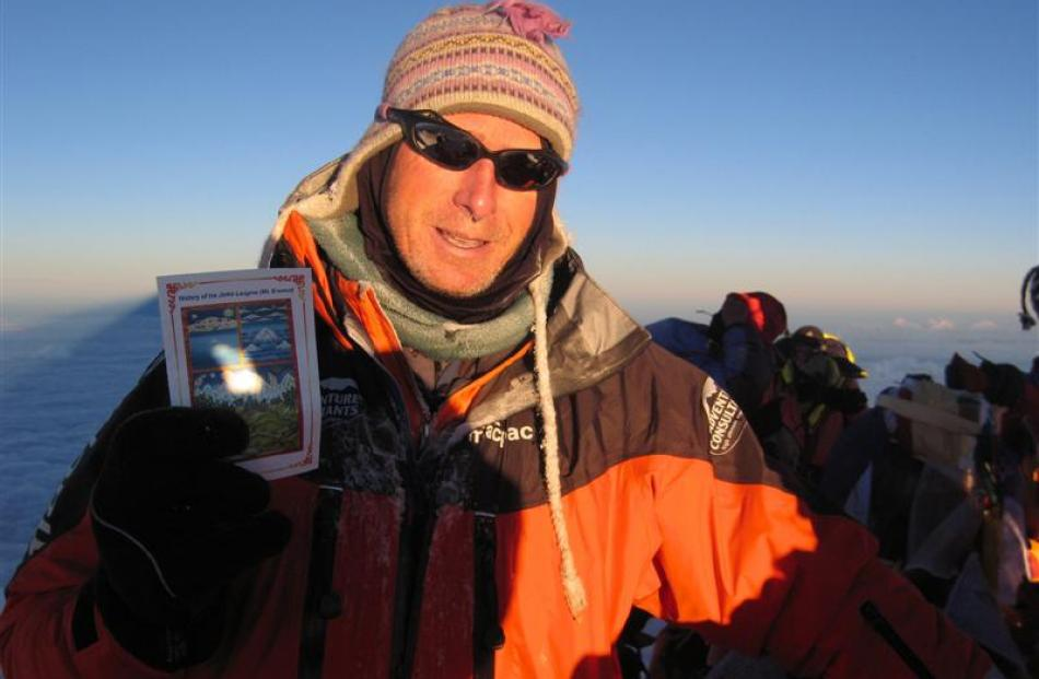 Mike Roberts on the summit of Everest in 2007. Photo supplied.