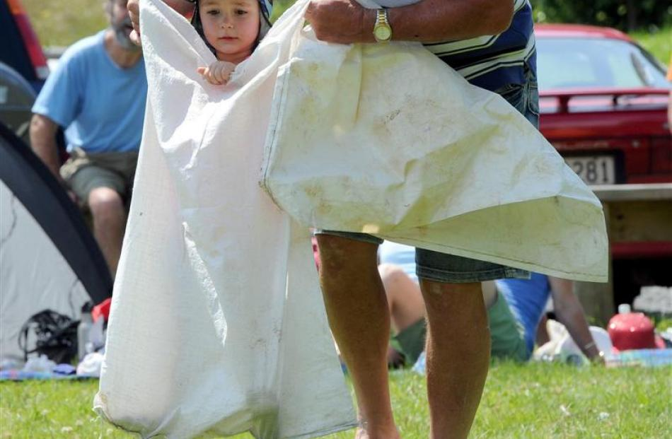 Olivia Harwood (3) gets a helping hand in a sack race.