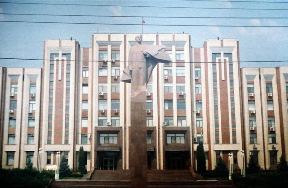 A Vladimir Lenin statue stands proud in front of  Trans Dniester parliament building.
