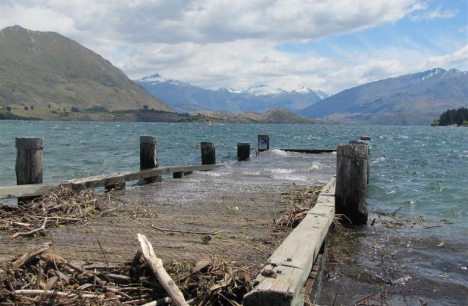 The Lake Wanaka wharf disappears beneath the waves. Photo by Mark Price.
