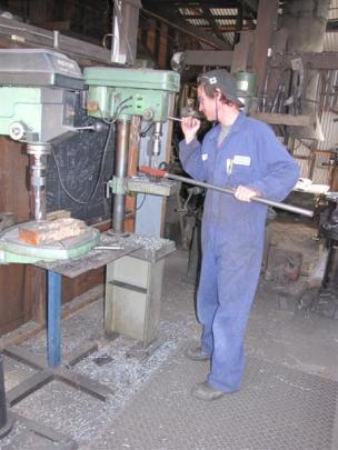 Staff member Paul Roach busy in the workshop.