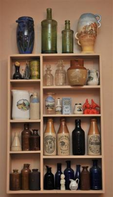 Various antique bottles, containers and jars decorate Russell Knowles' home.