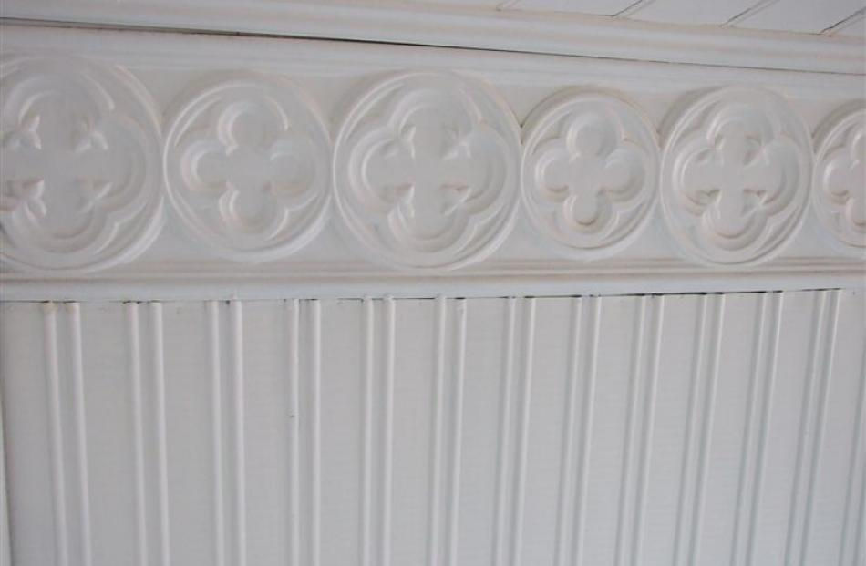 A close up view of the pressed sheet metal finish in the building's interior.