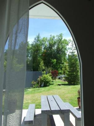French doors open to the garden area.