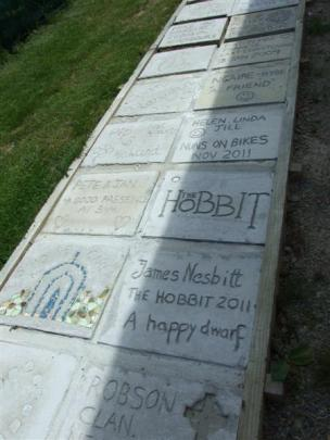 Milestones recorded and visitors' comments feature in this pathway of paving stones next to the...