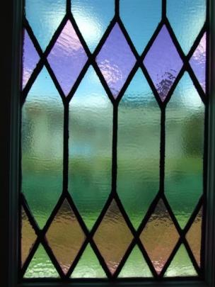 The base of a leadlight lancet window.