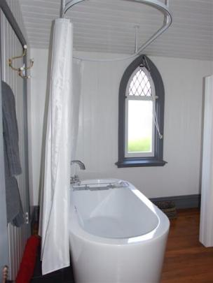 The former vestry has been converted into a bathroom.