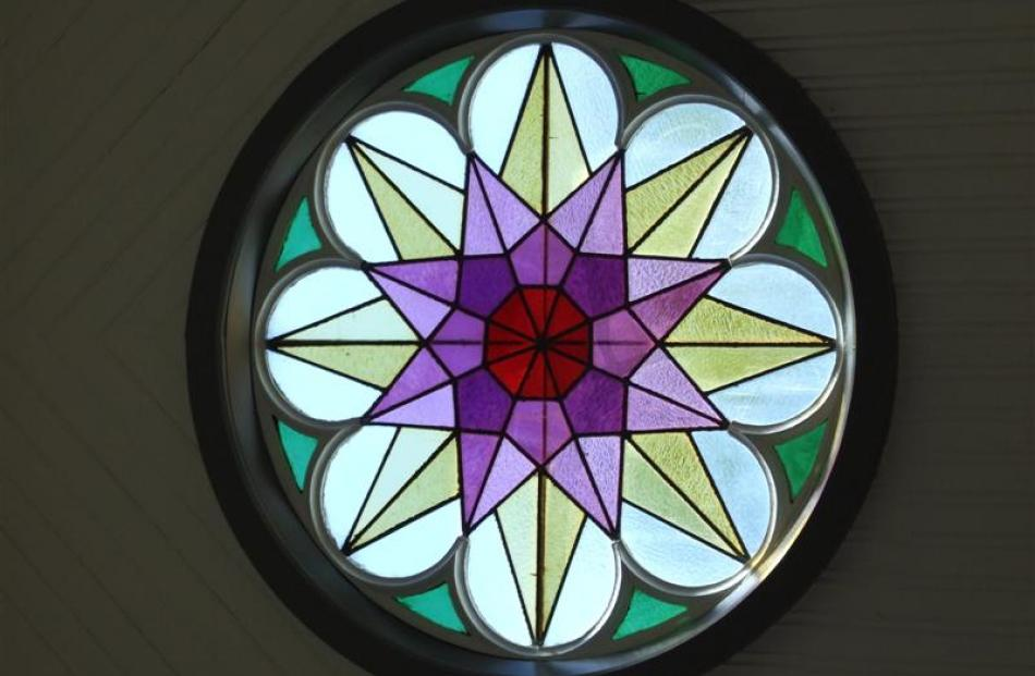 This eight-lobed leadlight rose window dominates the northern outlook.